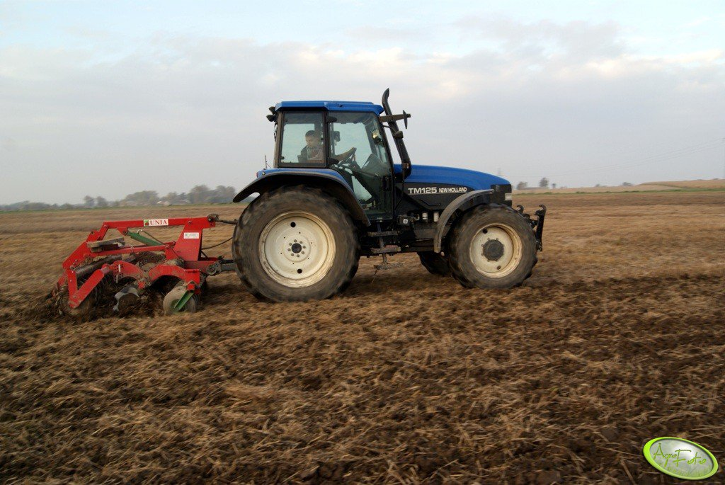 New Holland TM125 + ares