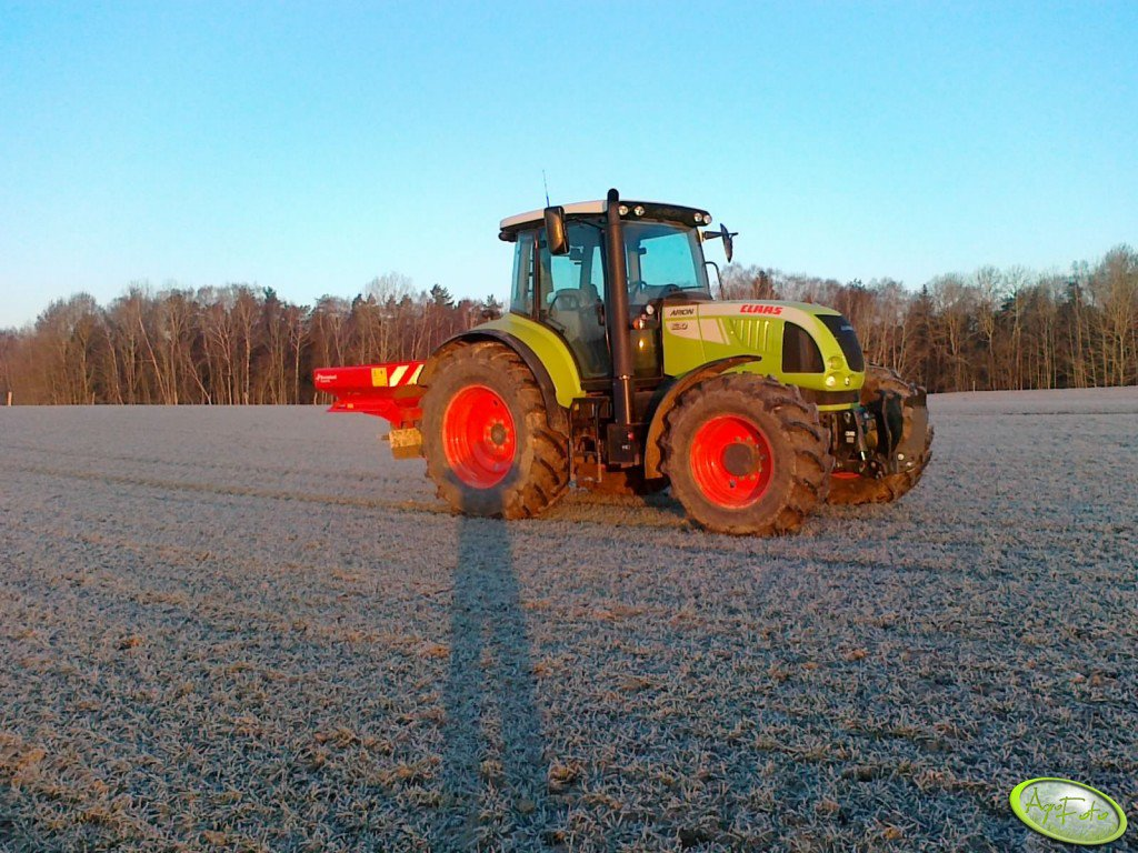 Claas Arion 630 C.I.S & rozsiewacz