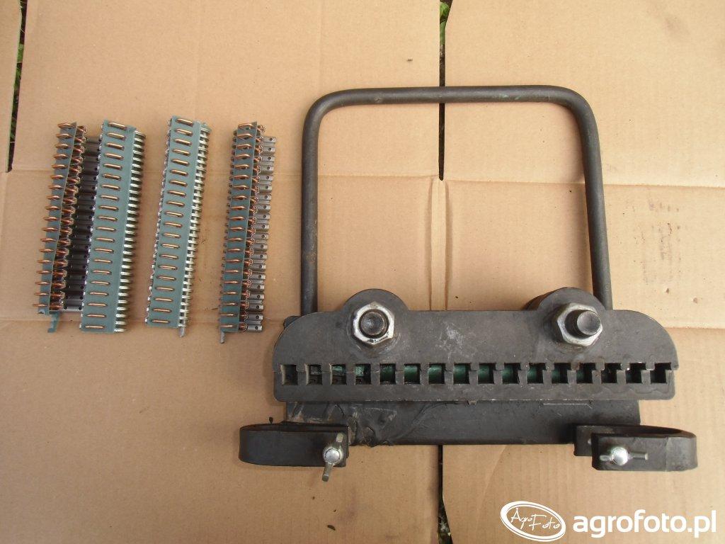 Urządzenie do spinania pasów