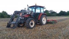 New holland L75 i talerzówka Agro-tom 3m